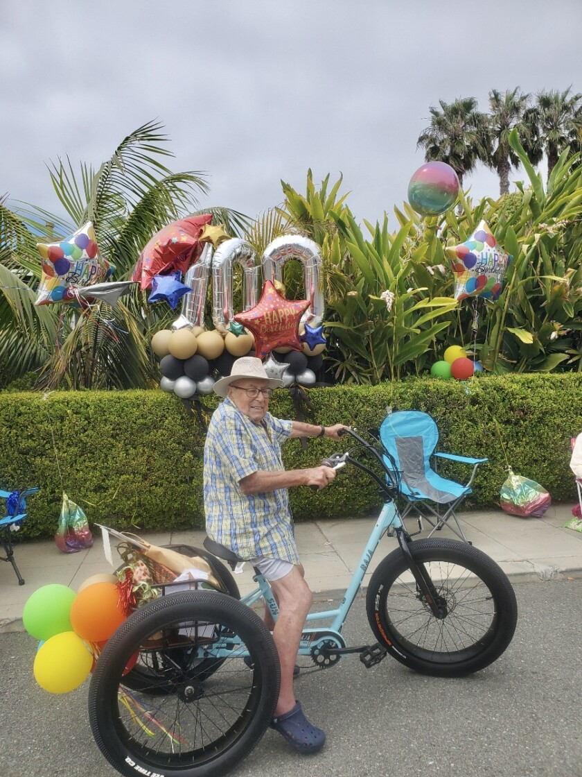 Werner Cahn of La Jolla tries his new motorized tricycle, a gift from his caretaker for his 100th birthday May 18.