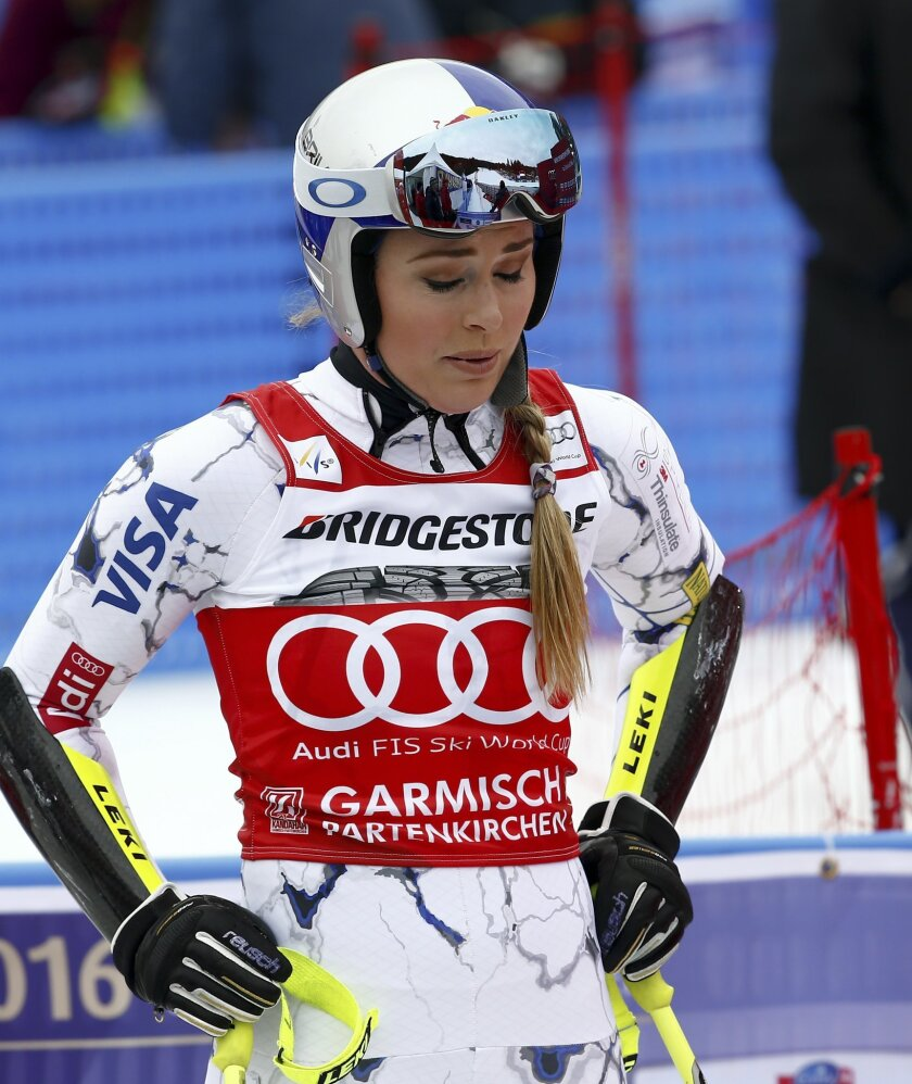 United States' Lindsey Vonn reacts at the finish area after completing an Alpine Ski women's World Cup Super G race, in Garmisch Partenkirchen, Germany, Sunday, Feb. 7, 2016. (AP Photo/Gio Auletta)