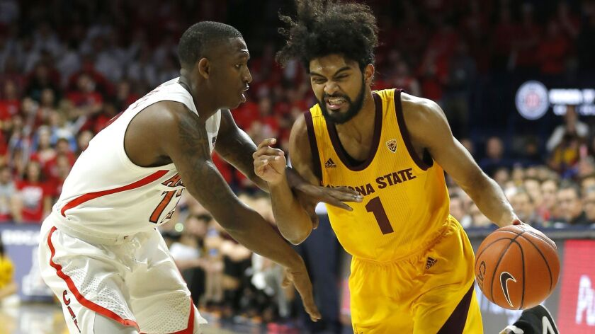 Arizona State guard Remy Martin, right, drives on Arizona guard Justin Coleman in the first half on Saturday in Tucson, Ariz.