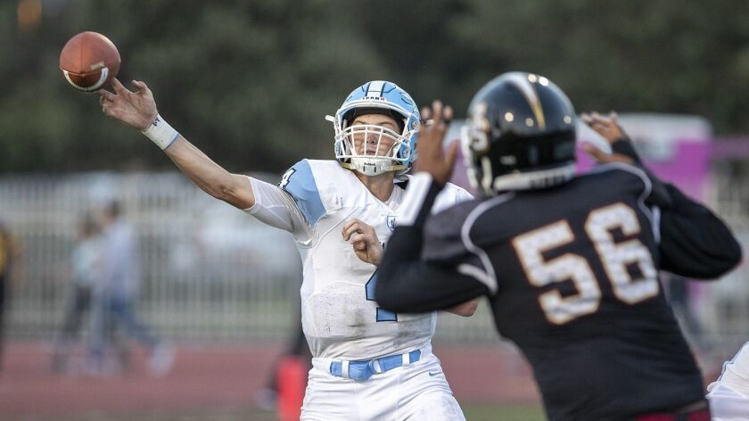 Corona del Mar's Ethan Garbers throws under pressure during a game against JSerra on Friday, August