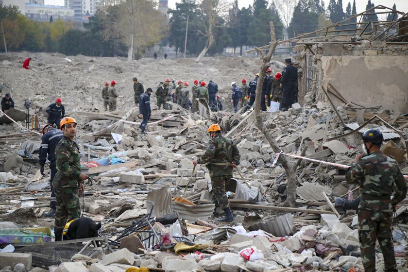 Rescuers search for survivors in a residential area in Gyanga, Azerbaijan, that was hit by rocket fire.