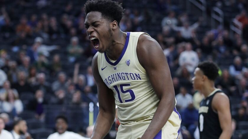 Washington's Noah Dickerson celebrates after a play against Colorado during the second half in the semifinals of the Pac-12 men's tournament on Friday in Las Vegas.