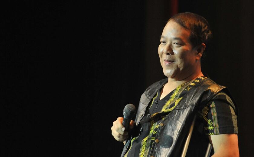 Viet Dzung on stage in Little Saigon.