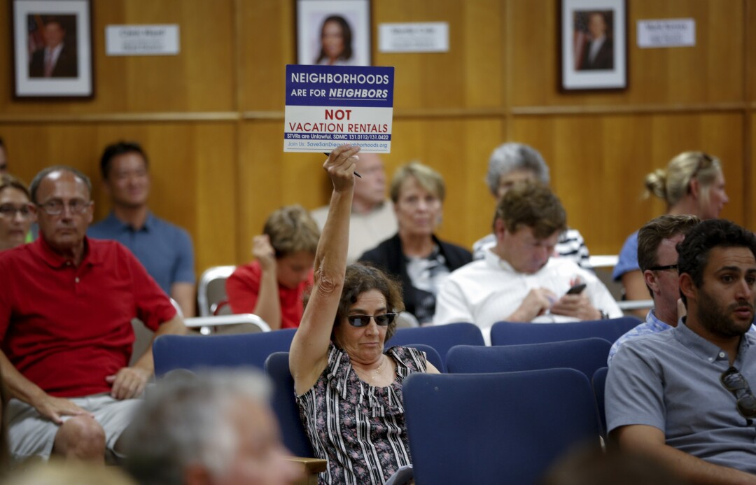 Dawn Sassi from University Heights, waved her sign showing her opposition for vacation rentals in San Diego.