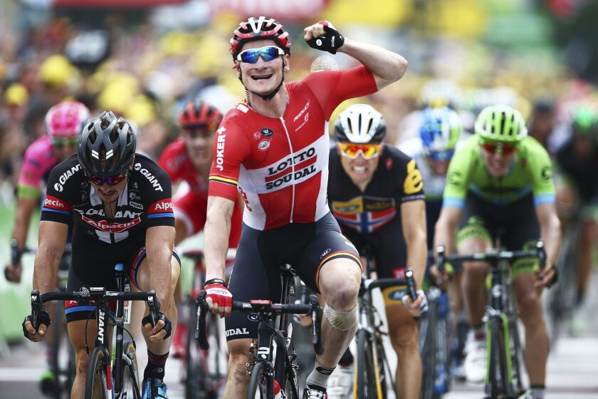 Germany's Andre Greipel celebrates as he crosses the finish line to win the the fifteenth stage of the Tour de France cycling race over 183 kilometers (113.7 miles) with start in Mende and finish in Valence, France,, Sunday, July 19, 2015. (AP Photo/Peter Dejong)