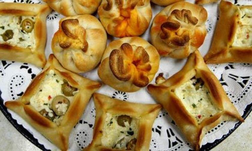 Potato Mushroom Puffs (round) and olive cheese bureks (square) are for sale at the Zaatar Factory and Bakery.