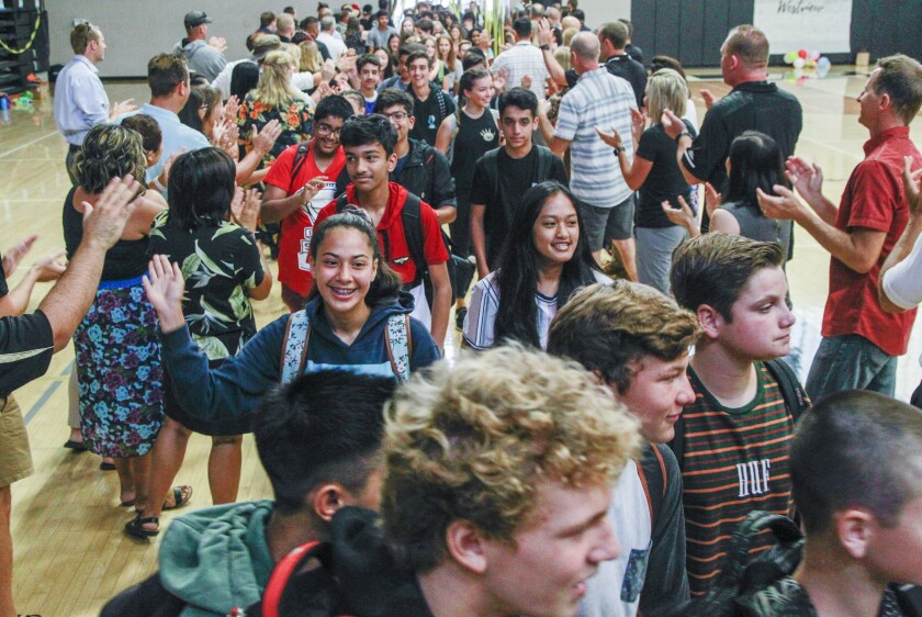 "Incoming freshman at Westview High School in San Diego pass through a ""Welcome Tunnel"" greeting faculty and staff on the first day of school."