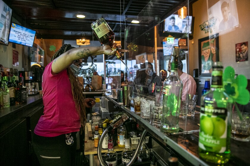 Bartender Christina Flintland serves drinks in Covina on Sunday.