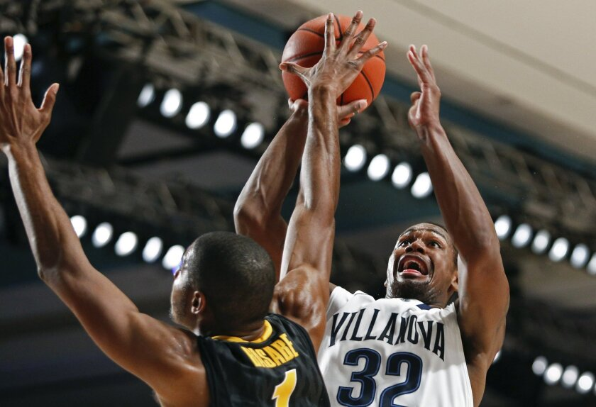 Villanova's James Bell, right, attempts to shoot for the basket as he's blocked by Iowa's Melsahn Basabe during the first half of an NCAA college basketball game in Paradise Island, Bahamas, Saturday, Nov. 30, 2013. (AP Photo/Bahamas Visual Services, Tim Aylen)