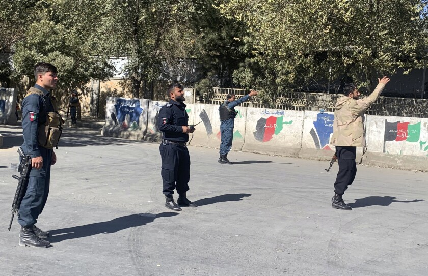 Afghan police arrive at the site of an attack at Kabul University in Kabul, Afghanistan.