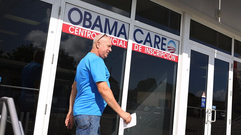 Alberto Abin walks out of the UniVista Insurance company office after shopping for a health plan under the Affordable Care Act, also known as Obamacare.