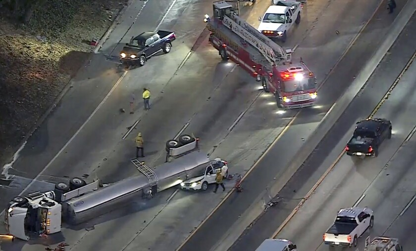 Southbound lanes of the 5 Freeway were closed in Boyle Heights on Tuesday morning after a milk tanker overturned