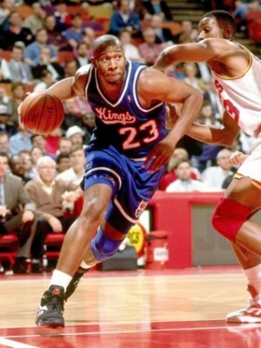 Wayman Tisdale, here playing for the Sacramento Kings in a 1994 game against the Houston Rockets, later became a leading contemporary jazz musician. Several of his albums made the charts.