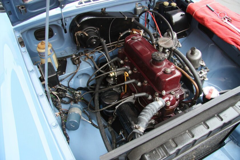The engine bay of this 1966 MGB might look entirely factory, but it has been upgraded with electronic ignition under the distributor cap.