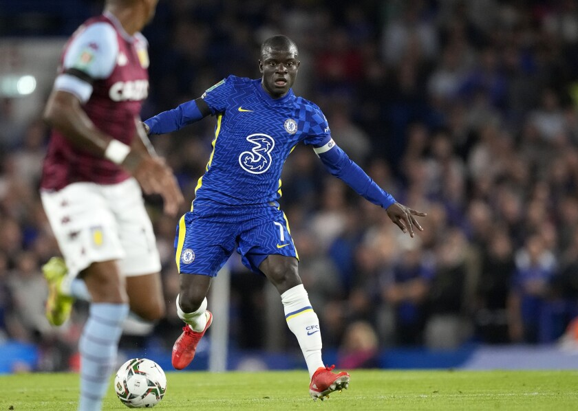 Chelsea's N'Golo Kante, right, controls the ball during the English League Cup third round soccer match between Chelsea and Aston Villa at Stamford Bridge Stadium in London, Wednesday, Sept. 22, 2021. (AP Photo/Frank Augstein)
