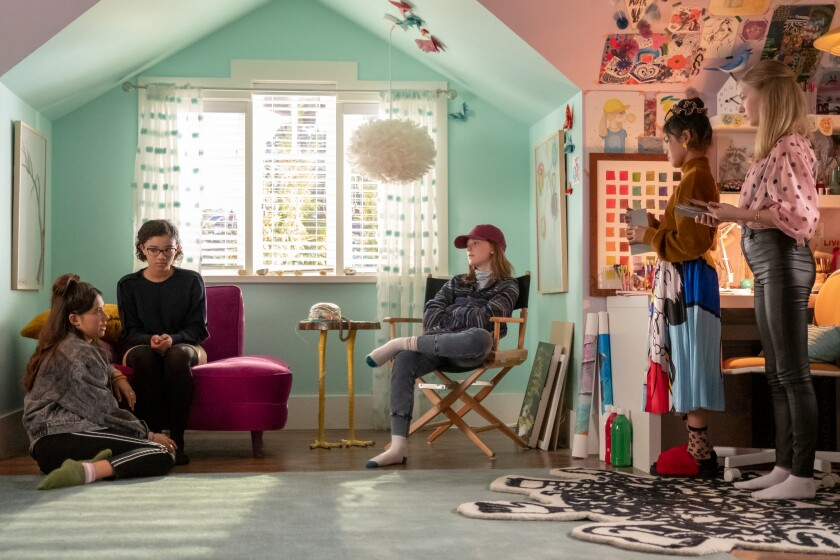 "Xochitl Gomez, left, Malia Baker, Sophie Grace, Momona Tamada and Shay Rudolph in ""The Baby-Sitters Club."""