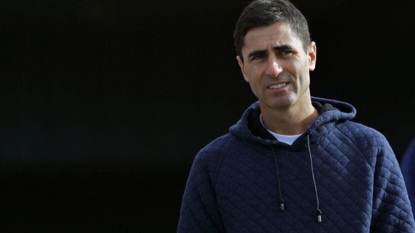 Padres General Manager A.J. Preller looks on during a spring training practice in Peoria on Feb. 15, 2018.