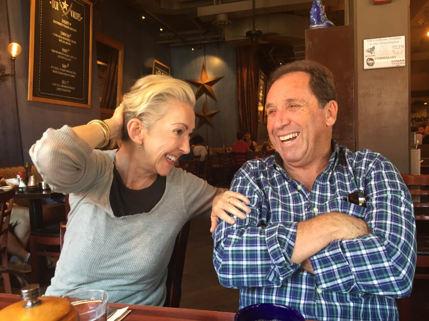 Jane and Raymond Wurwand laugh as they sit at a local restaurant.