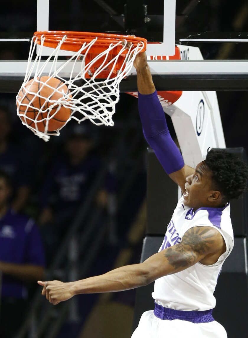 Kansas State forward Wesley Iwundu (25) slam a dunk Sunday, Nov. 29, 2015, during an NCAA college basketball game against South Carolina State in Manhattan, Kan. (Bo Rader/The Wichita Eagle via AP) LOCAL TELEVISION OUT; MAGAZINES OUT; LOCAL RADIO OUT; LOCAL INTERNET OUT; MANDATORY CREDIT