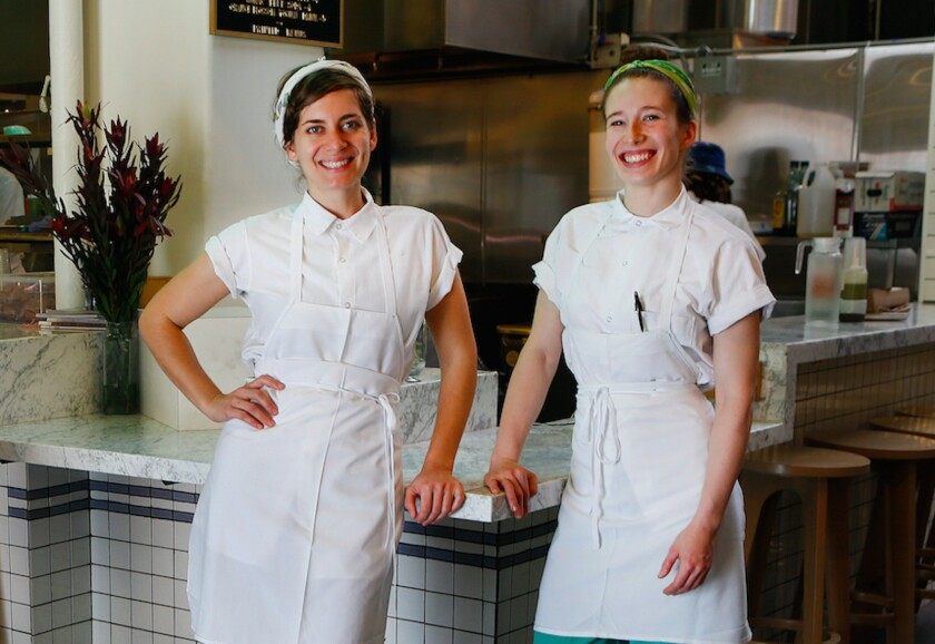 Sara Kramer, left, and Sarah Hymanson in front of their falafel stand Madcapra in Grand Central Market in downtown Los Angeles. The two have teamed up with Jon Shook and Vinny Dotolo of Animal to open a restaurant called Kismet in Los Feliz.