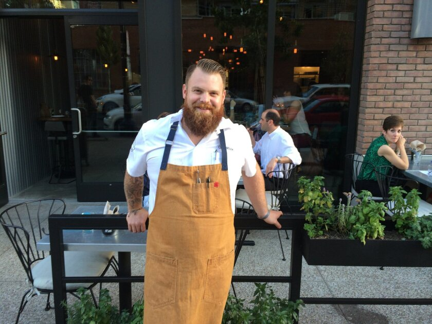"Chef Chad White in front of his new East Village ""street chic"" eatery, Común Kitchen and Tavern."