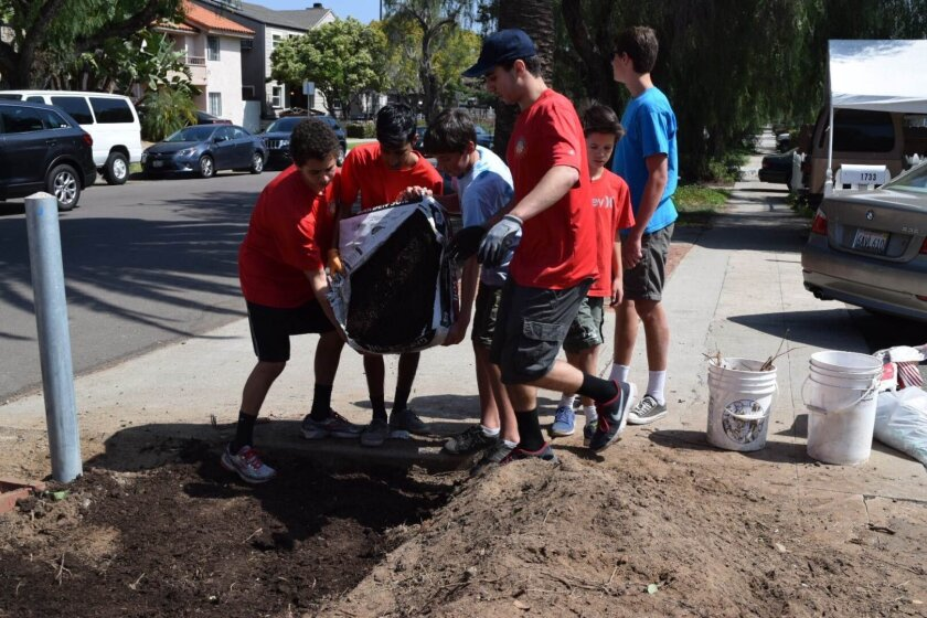 Marc Farah, Sajan Alagiri, Casey Holden, Joe Farah, Philippe Covington and Eddie Parker help prepare the garden soil. Helpers not pictured: Nick and Casey Holden, Cade Kronemeyer, Gabe Punta, Harry Hixson, Eddie Parker, Chase Maisel, Ryan Finley, Brian Donnelly and Patrik Kjos.