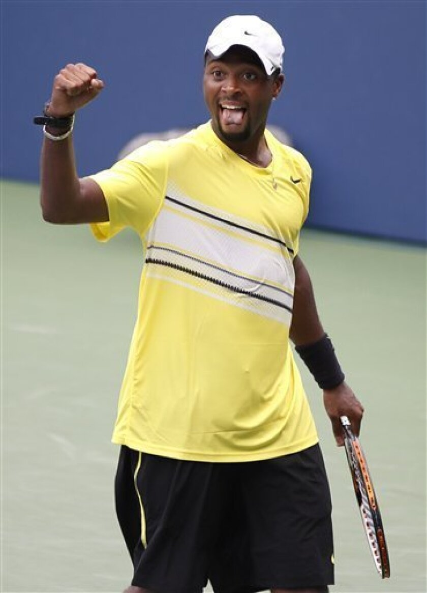 Donald Young reacts after winning his match against Juan Ignacio Chela of Argentina during the U.S. Open tennis tournament in New York, Sunday, Sept. 4, 2011. (AP Photo/Charlie Riedel)