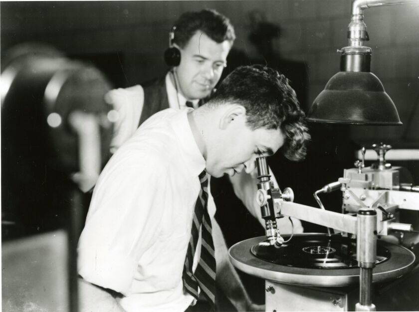 Sound engineer cutting a record lacquer