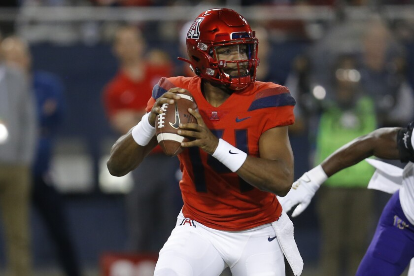 Arizona quarterback Khalil Tate drops back to pass against Washington on Saturday in Tucson.