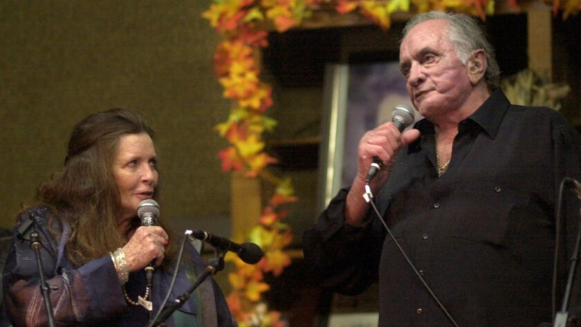 "June Carter Cash and husband Johnny Cash perform in Hiltons, Va., in 2002. Johnny Cash's previously unpublished writings are the source of a new album, ""Johnny Cash: Forever Words,"" featuring a raft of country, rock and bluegrass musicians."