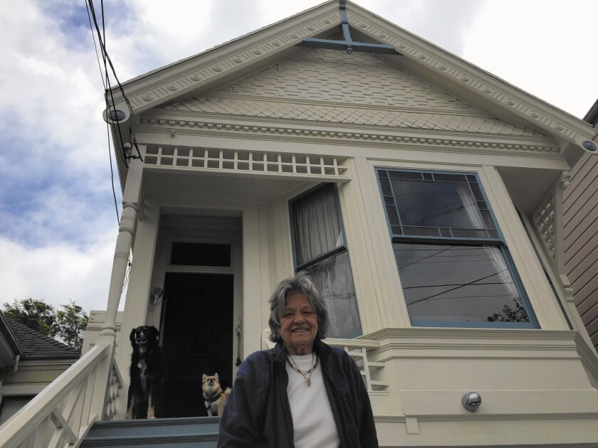 Judith Davis, 71, lives in a Victorian in San Francisco's Noe Valley and says renting out her street-level flat on Airbnb has allowed her to make ends meet.