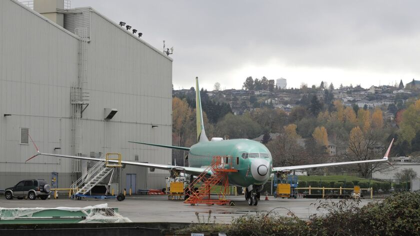 FILE- In this Nov. 14, 2018, file photo a Boeing 737-MAX 8 is parked outside Boeing Co.'s 737 assemb
