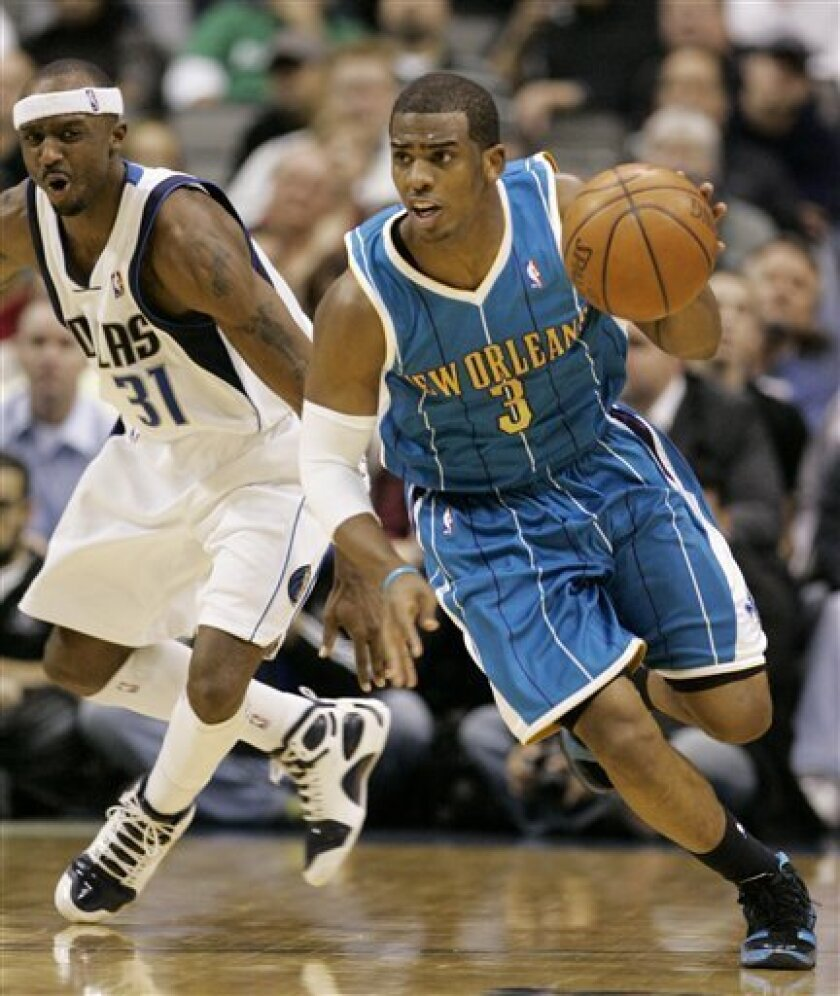 New Orleans Hornets guard Chris Paul (3) steals the ball from Dallas Mavericks guard Jason Terry (31) during the second half of an NBA basketball game in Dallas, Wednesday, Jan. 14, 2009. The Hornets won 104-97. (AP Photo/Tony Gutierrez)