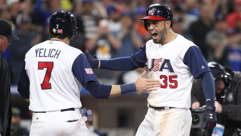 SAN DIEGO, March 15, 2017 | USA's Eric Hosmer, right, celebrates with Christian Yelich after Hosmer