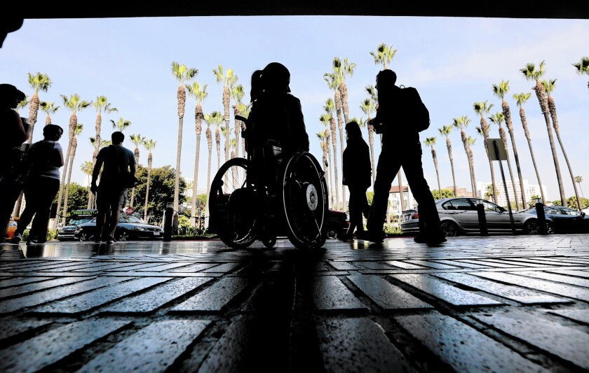 A woman in a wheelchair outside Union Station in downtown Los Angeles.