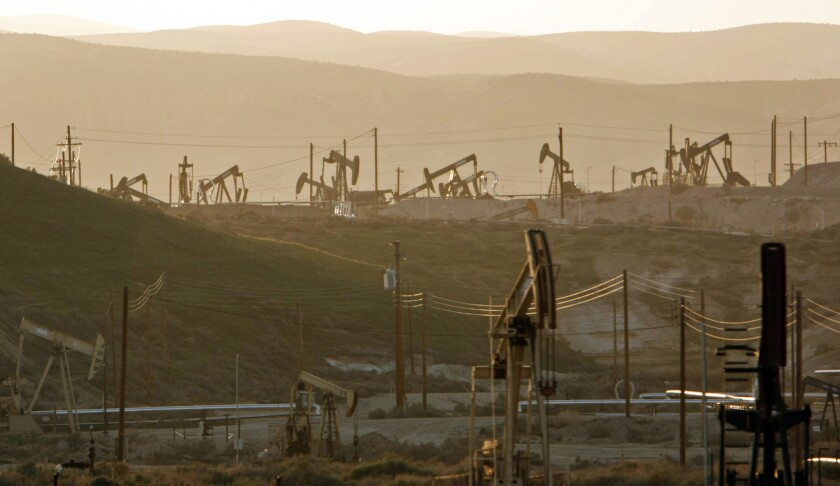 Oil rig pump jacks tap into the Monterey shale formation near Maricopa, Calif.