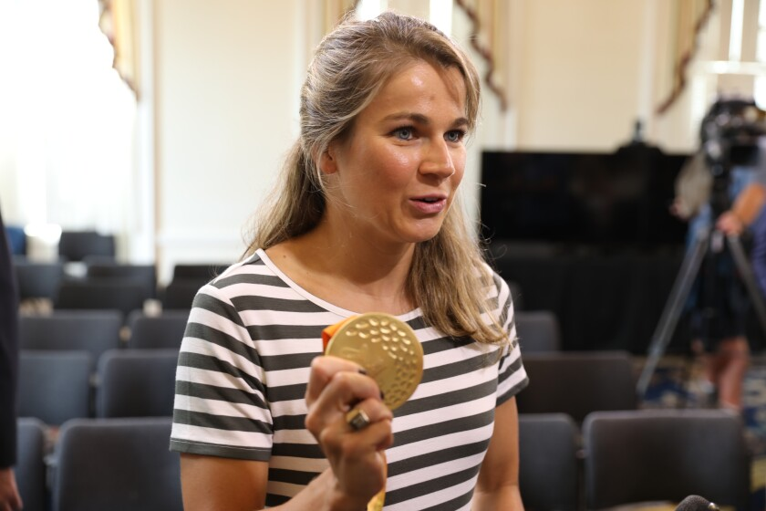 Becca Meyers with gold medal from 2016 Paralympics