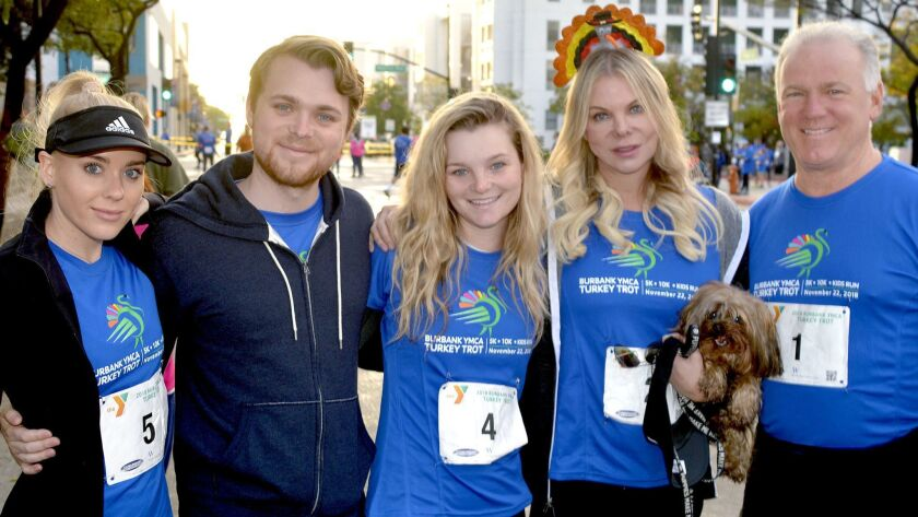 Among those who trotted on turkey day to benefit the YMCA were Michael, from right, Caroline, and he