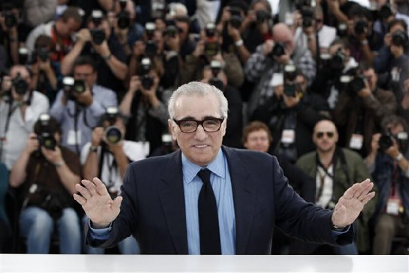 American director Martin Scorsese reacts as he attends a photo call for the World Cinema Foundation at the 62nd International film festival in Cannes, southern France, Friday, May 15, 2009. (AP Photo/Matt Sayles)