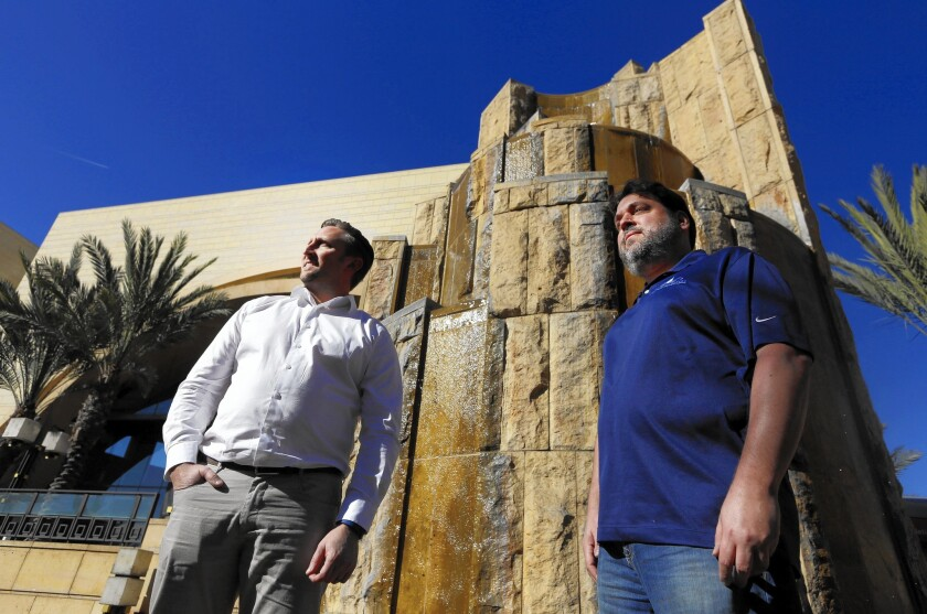 Mark Pitman, left, and Jeffrey Barman, co-owners of California Waters, a business that designs, installs and repairs decorative fountains, stand next to the Arroyo Fountain at L.A.'s Union Station.