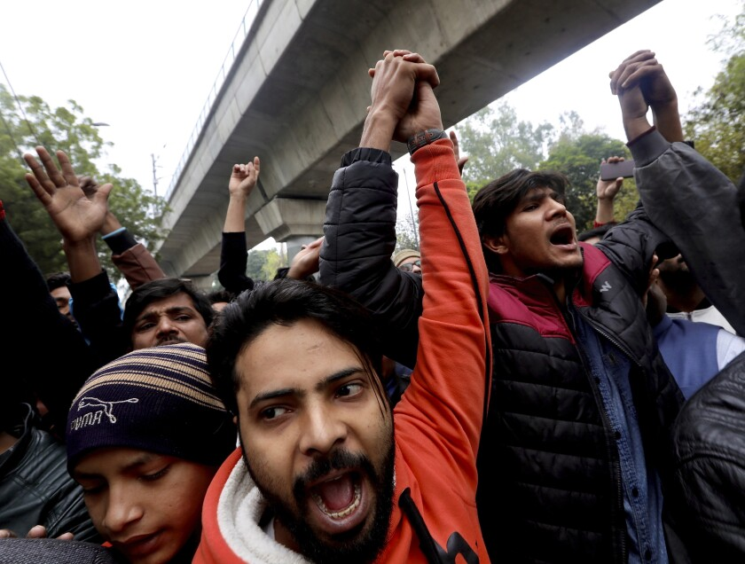 Students from Jamia Millia Islamia University take part in a protest in New Delhi on Monday. The Citizenship Amendment Bill, which was approved by Parliament last week, has sparked protests across India.