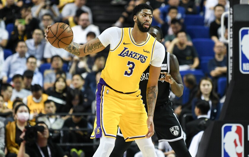 Lakers forward Anthony Davis receives a pass while playing against the Nets in Shanghai on Oct. 10, 2019.