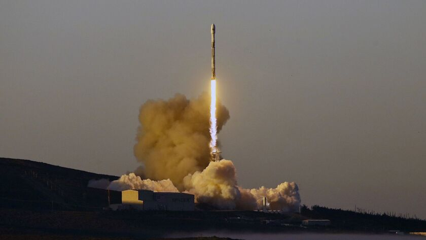 A SpaceX Falcon 9 rocket lifts off from Vandenberg Air Force Base in California on March 30.