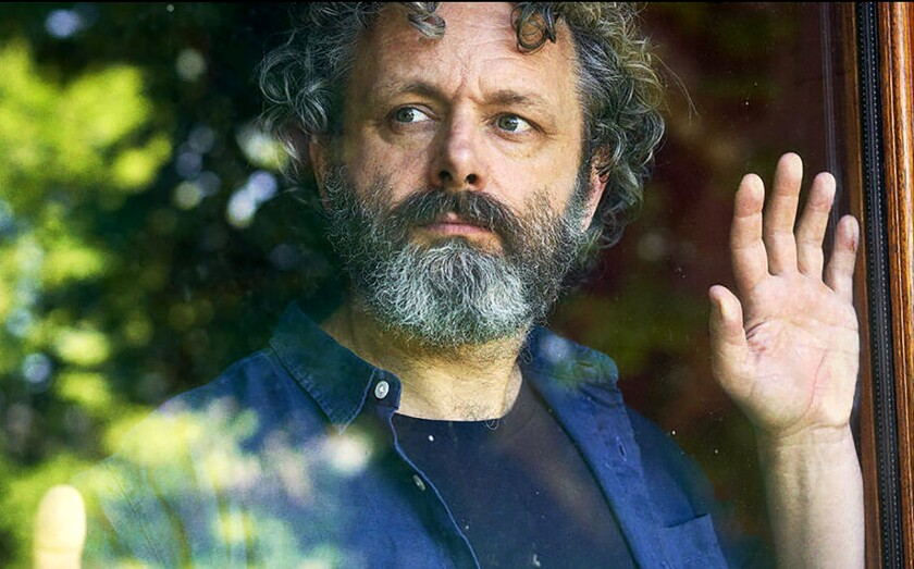"""Michael Sheen looks out a window in """"Staged."""""""
