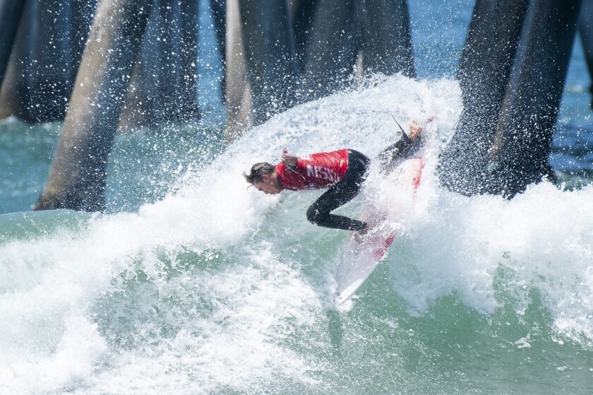 Sage Tutterow cuts back on a wave during the men?s open round 4 of the National Scholastic Surfing A