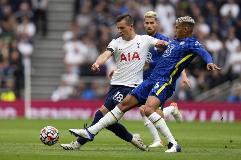 Chelsea's Thiago Silva vies for the ball with Tottenham's Giovani Lo Celso, left, during the English Premier League soccer match between Tottenham Hotspur and Chelsea at the Tottenham Hotspur Stadium in London, England, Sunday, Sep. 19, 2021. (AP Photo/Matt Dunham)