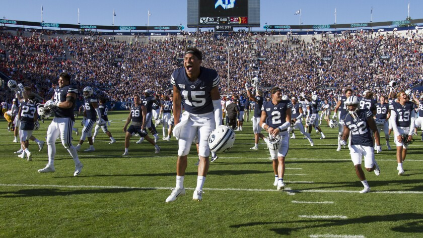 BYU wide receiver Aleva Hifo celebrates the Cougars' overtime victory against USC on Saturday.