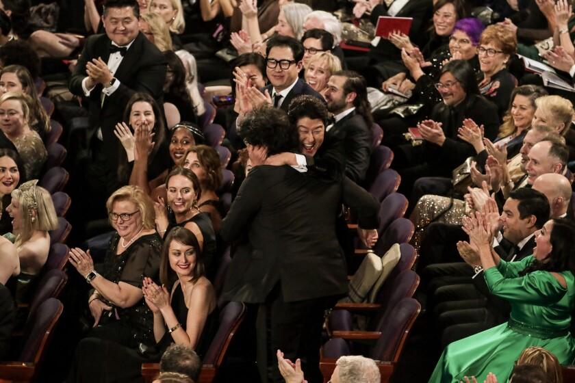 """Song Kang Ho congratulates Bong Joon Ho, winner of the international feature Oscar for """"Parasite,"""" during the telecast of the 92nd Academy Awards."""