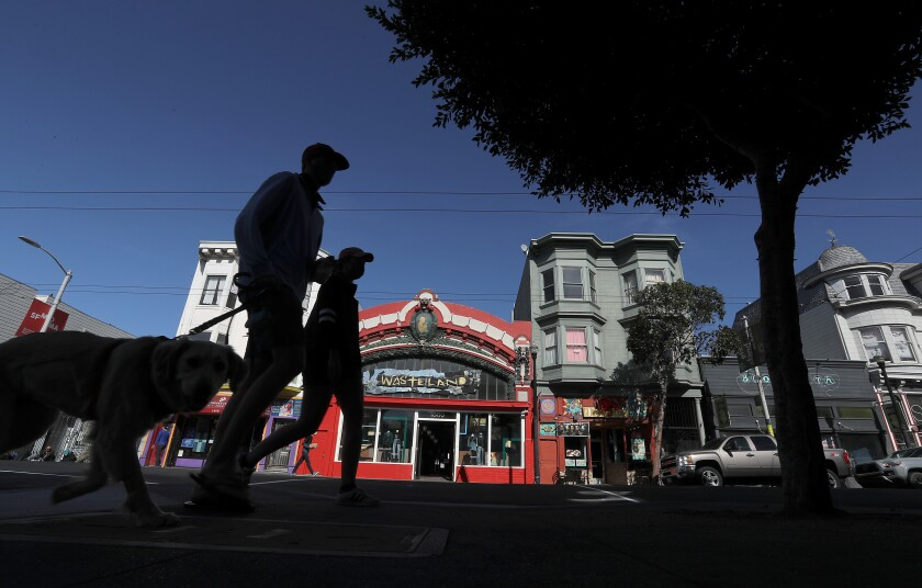 Pedestrians walk along Haight Street in San Francisco.