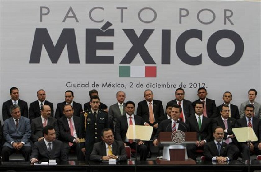 Mexico's President Enrique Pena Nieto, front, third from left, delivers a speech during a signing agreement ceremony in Mexico City, Sunday, Dec. 2, 2012. Newly inaugurated President Enrique Pena Nieto and top opposition leaders have signed an agreement to increase Mexico's economic growth, employment and competitiveness. (AP Photo/Marco Ugarte)